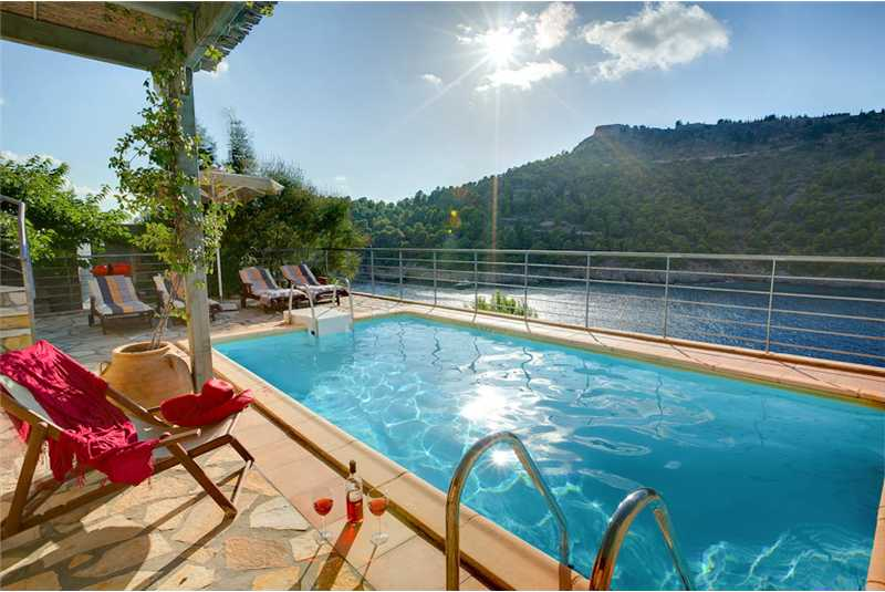 Villa Akrogiali relax by the pool with a glass of wine