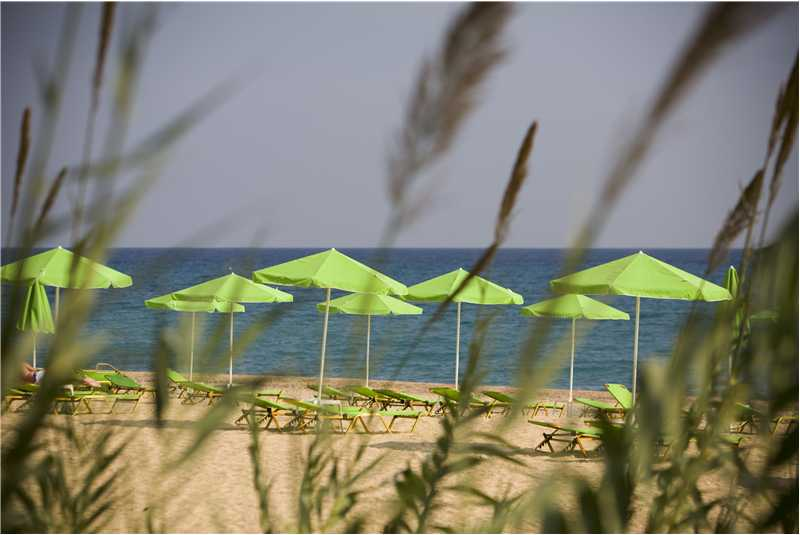 Sunloungers and parasols on Skala beach