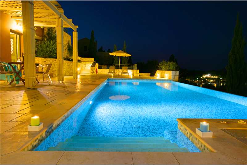 Villa Jasemi pool illuminated at night
