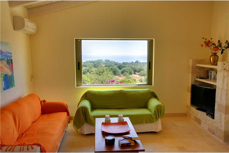 Villa Litorina relax  in the lounge admiring the views