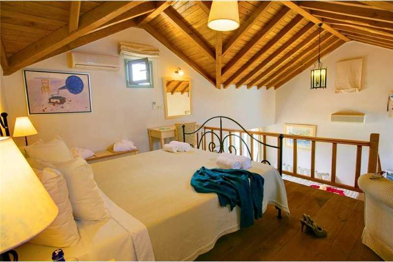 Villa Thea double bedroom with high vaulted wooden ceilings