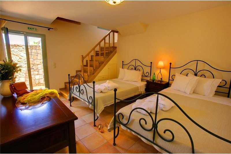 Villa Thea twin bedroom with pool access