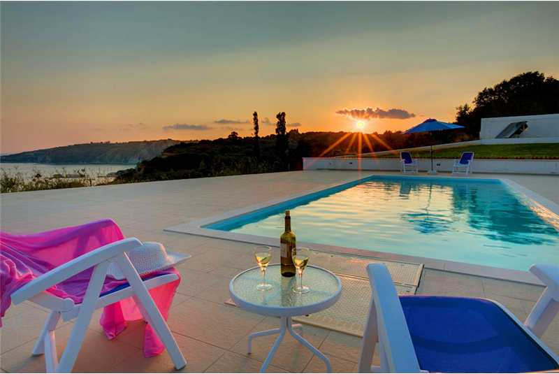 Villa Pessada relax with a glass of wine as the sun sets