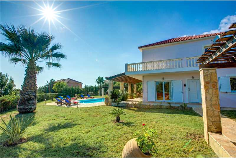 Villa Athena sideview landscaped gardens